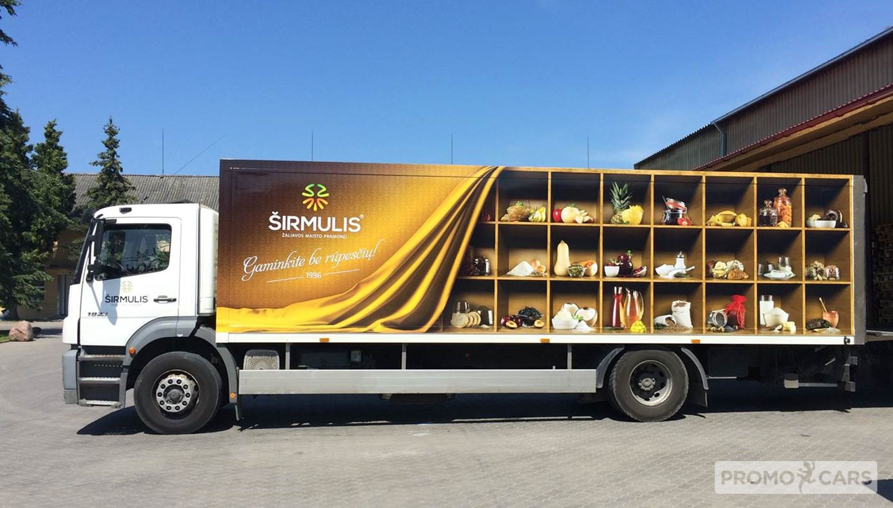 Sunkvežimių apklijavimas reklamine plėvele